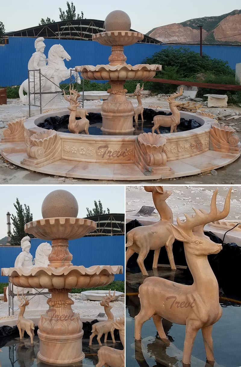 Backyard tiered rolling marble ball fountain with stag statues detail