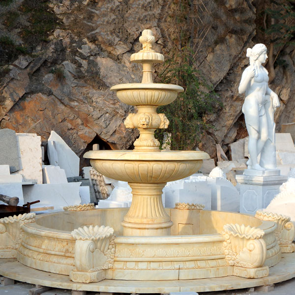 Outdoor classical three tiered water fountains in the center of the garden