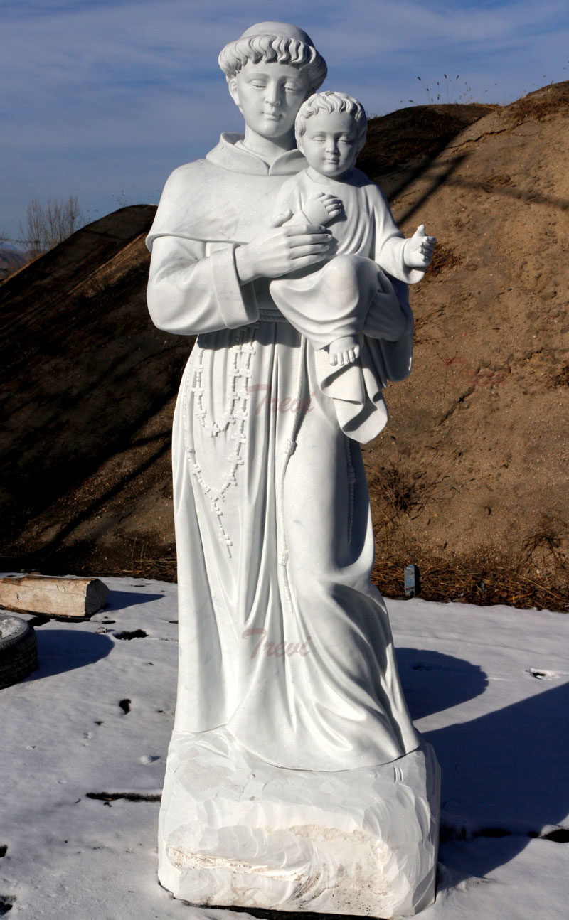 Catholic garden sculptures of saint Anthony with child jesus design details
